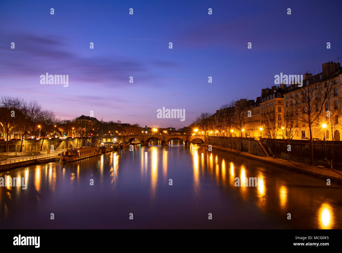 The Pont Marie over the Seine and the Il St Louis at dusk; Paris, France, Europe - Stock Image