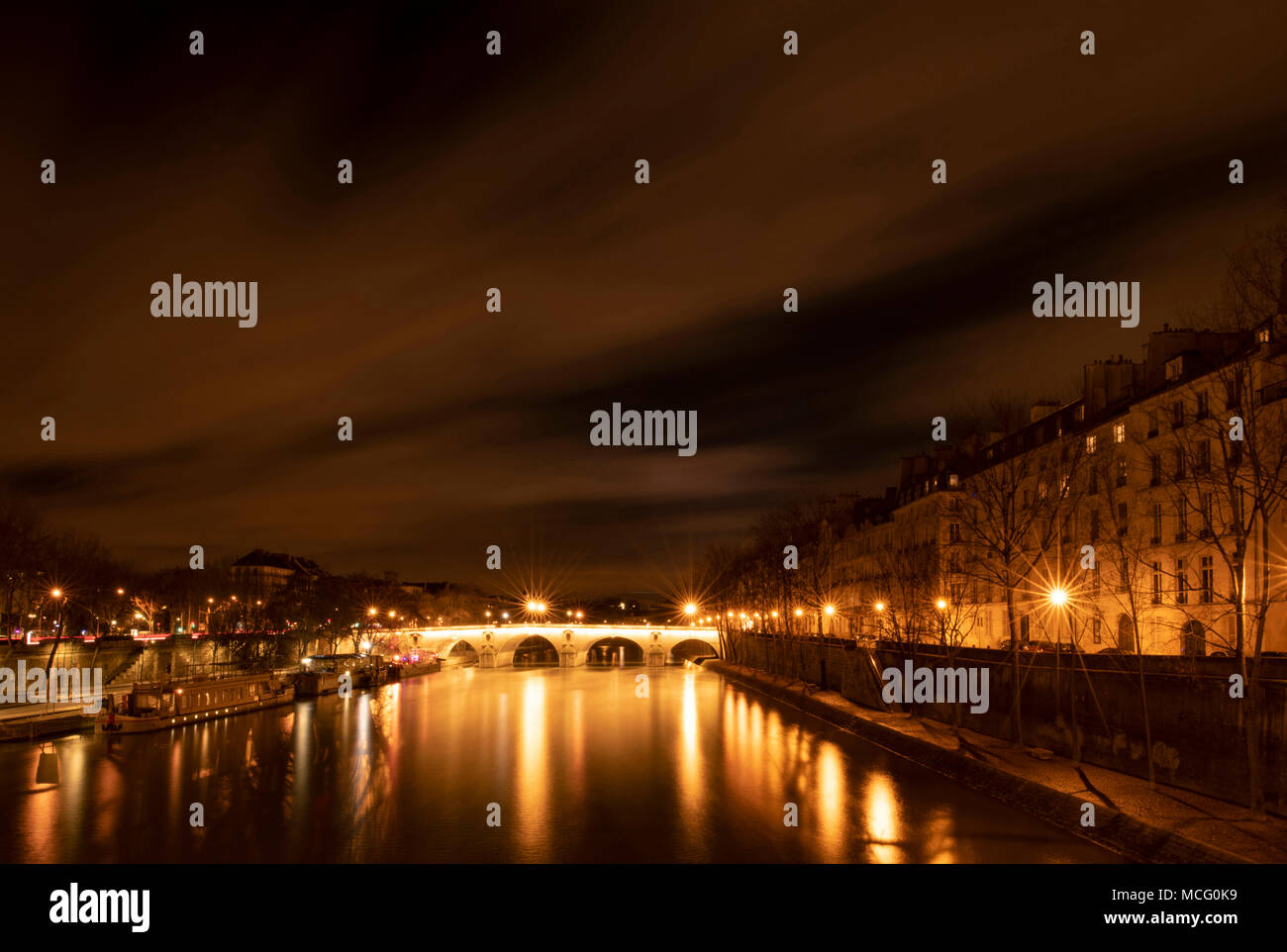 A night time view of the Pont Marie, the Il St Louis and reflections on the Seine. Paris, France, Europe - Stock Image