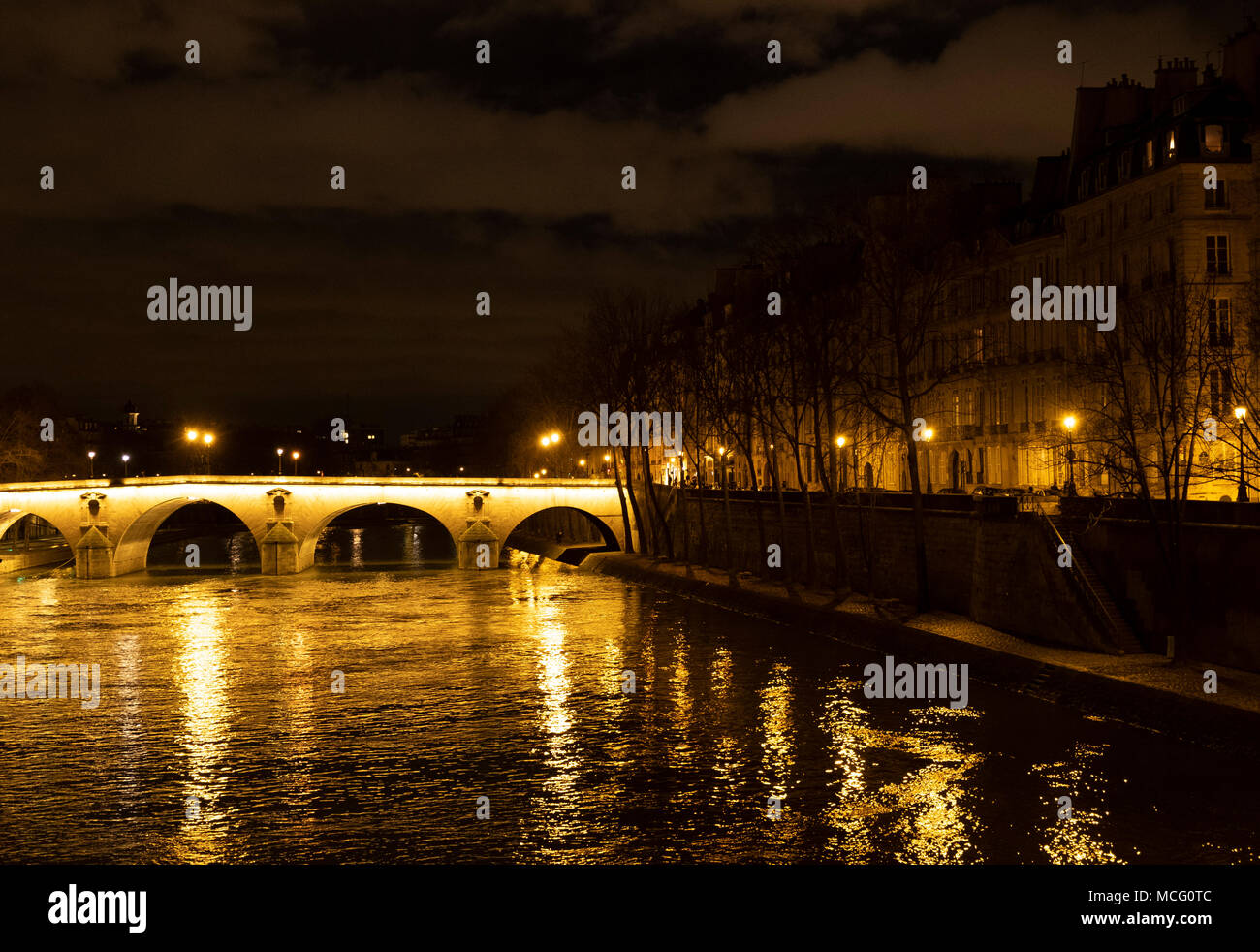 The Pont Marie, the Il St Louis and lights reflected on the Seine at night. Paris, France, Europe - Stock Image