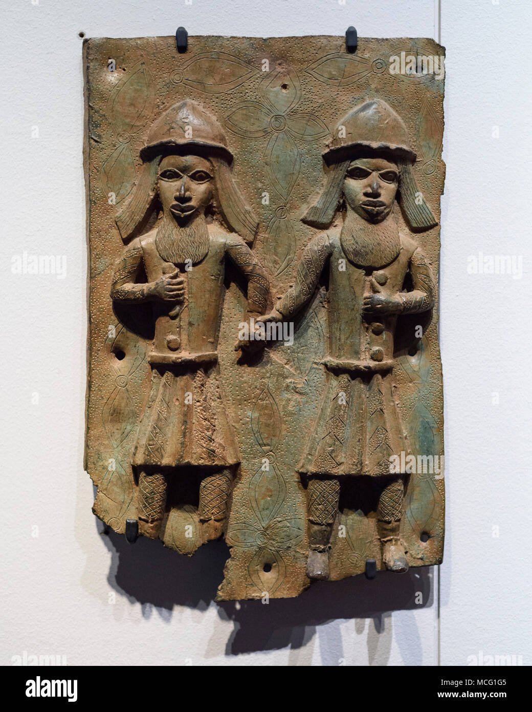 Berlin. Germany. Benin Bronzes. Representation of a Portuguese man, brass plaque. 16-17th century. From the royal court palace of the Kingdom of Benin - Stock Image