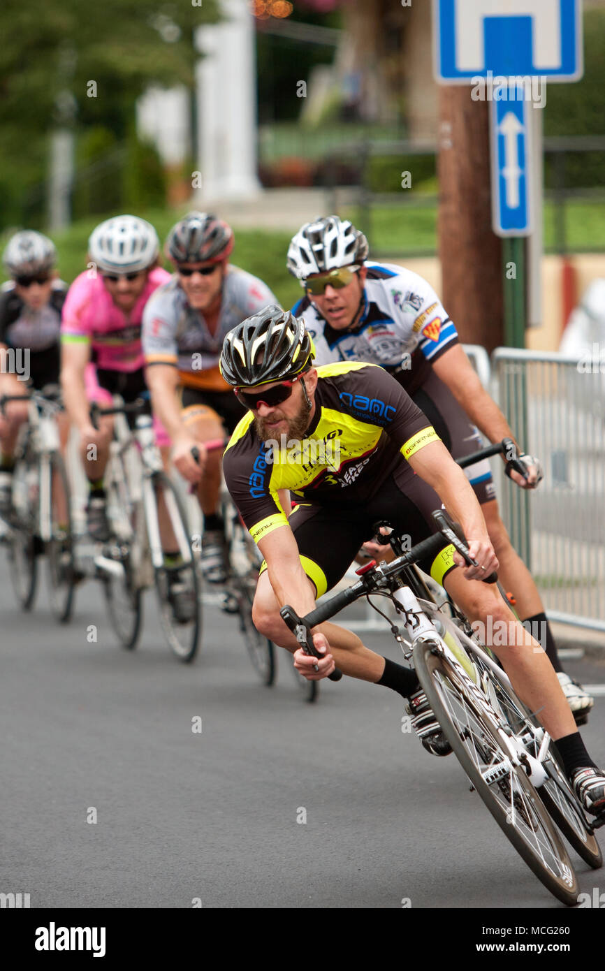 A group of cyclists race into a turn on a downtown Duluth