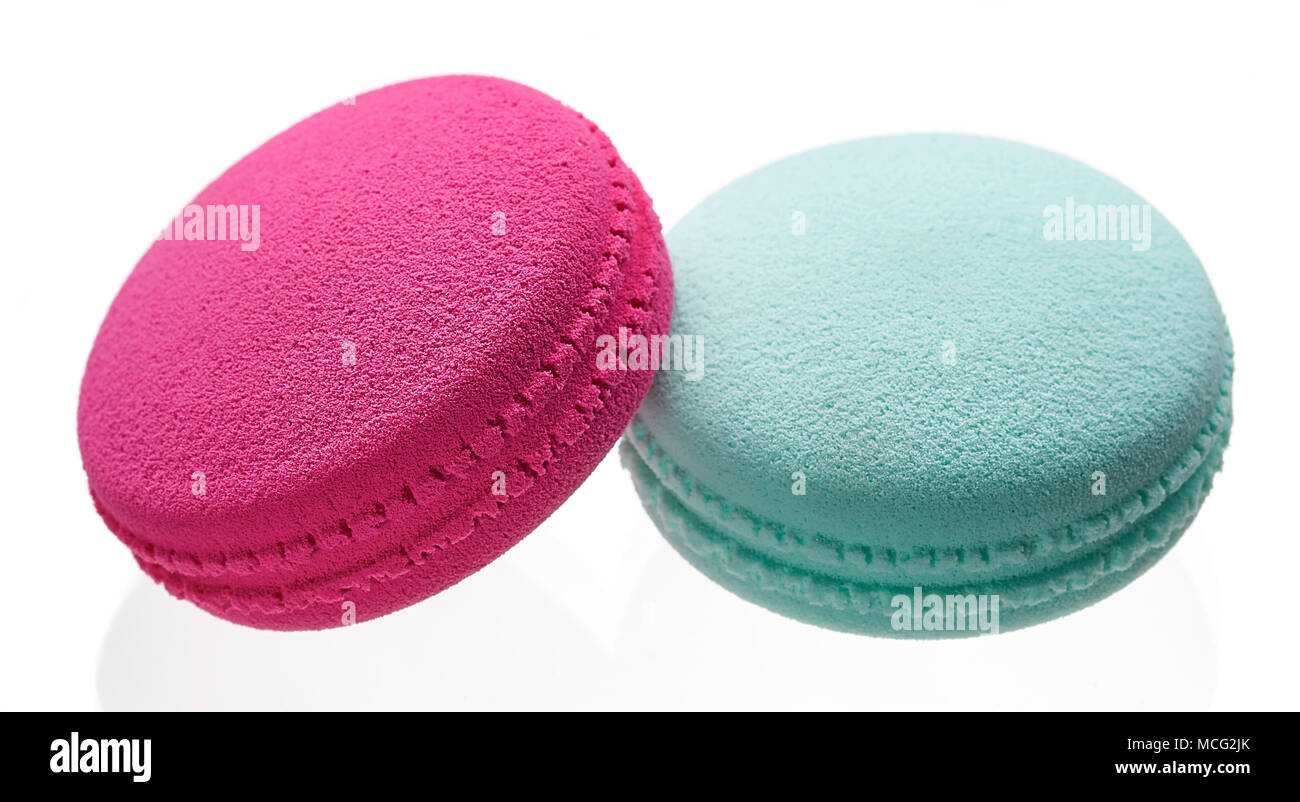 exclusive sponge for applying and feathering make-up in the form of macaroons cakes on a white background - Stock Image