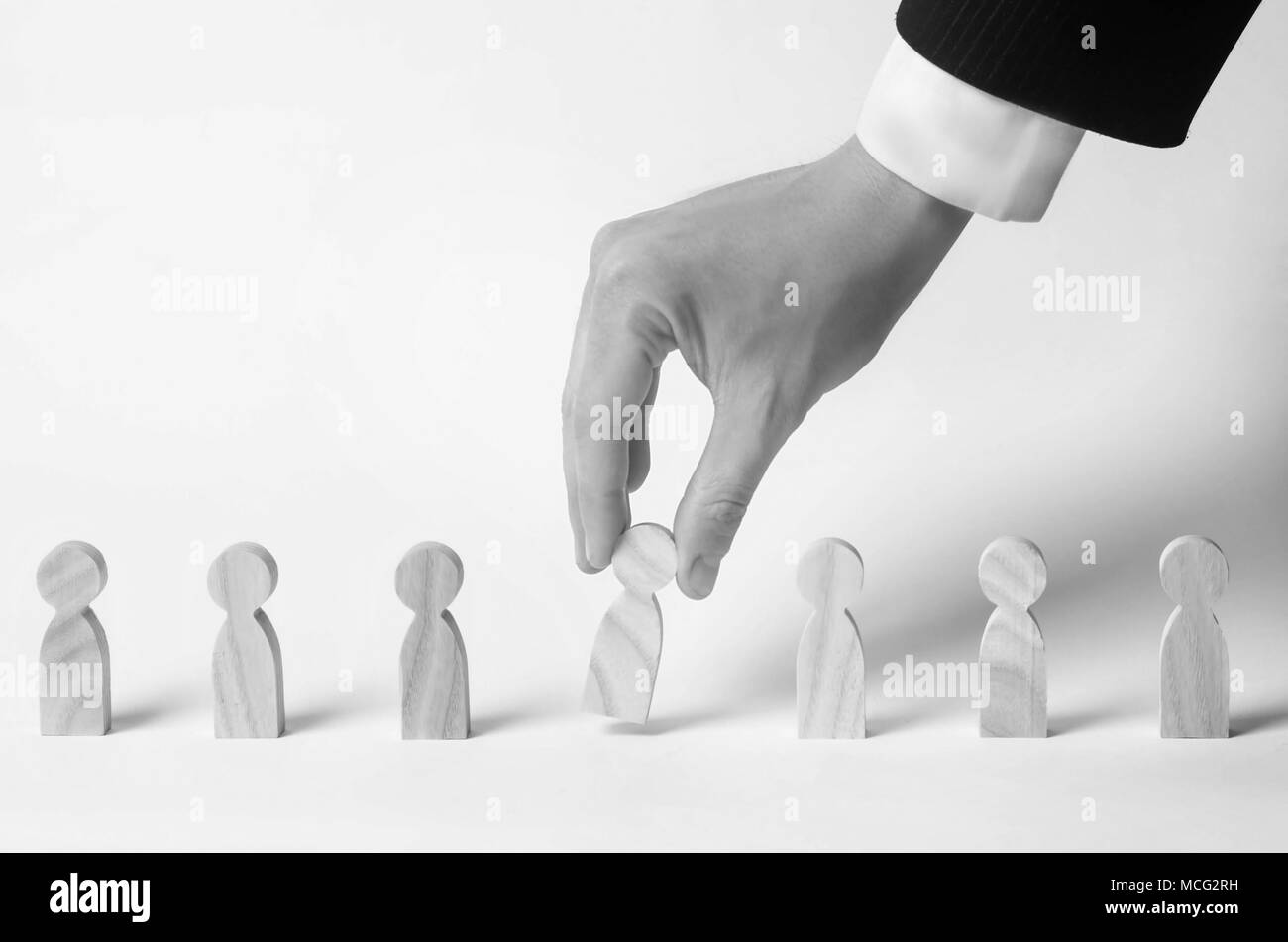 Businessman in search of new employees and specialists. The concept of personnel selection and management within the team. Dismissal and hiring people - Stock Image