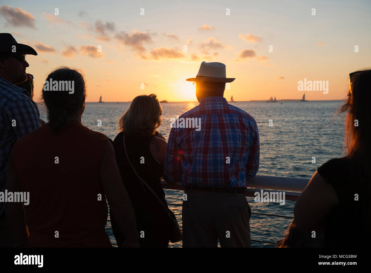 People watching the sunset from Mallory Square in Key West, Florida. Stock Photo