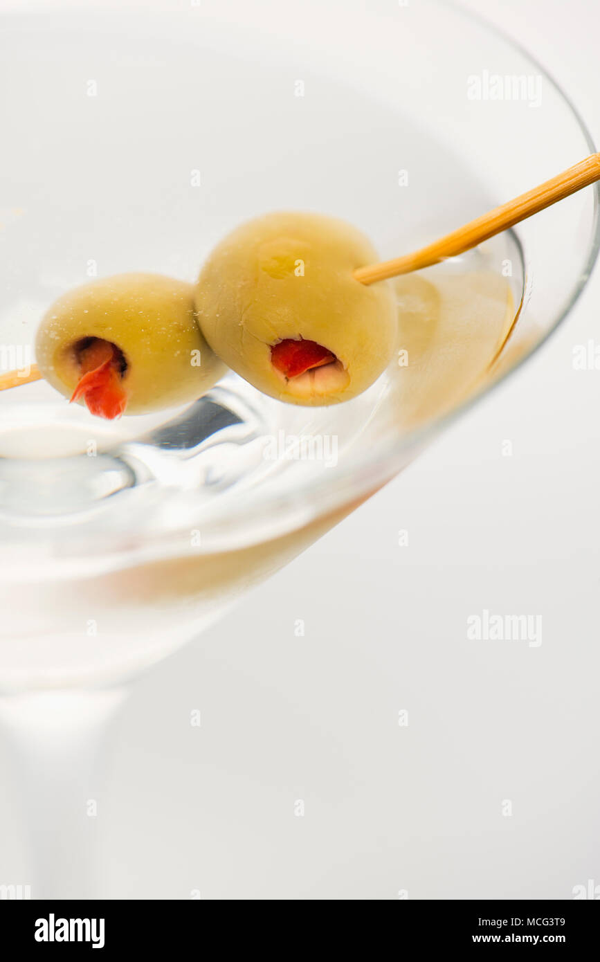 A close up of a dirty martini with olives. Stock Photo