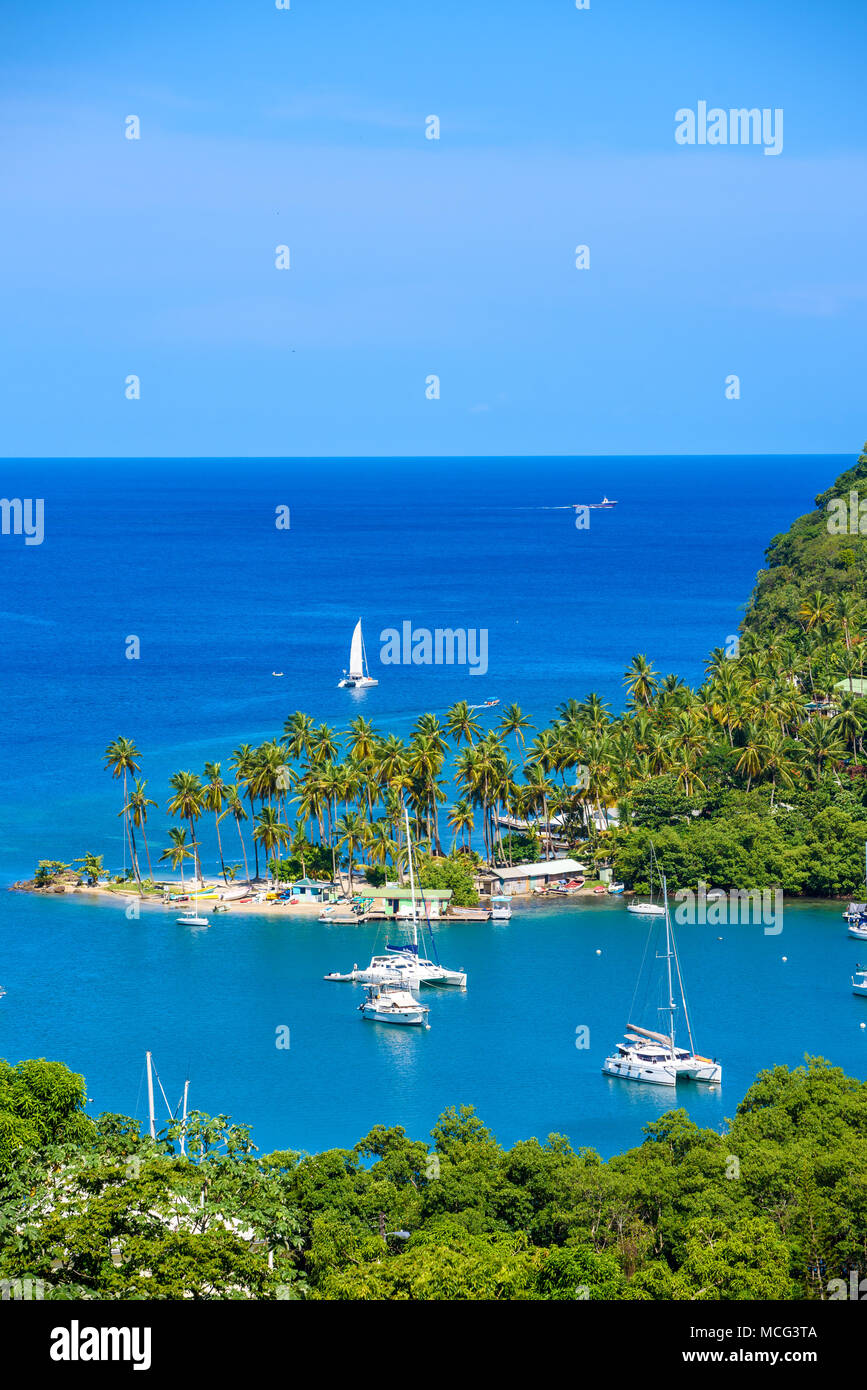 Marigot Bay, Saint Lucia, Caribbean. Tropical bay and beach in exotic and paradise landscape scenery. Marigot Bay is located on the west coast of the  - Stock Image
