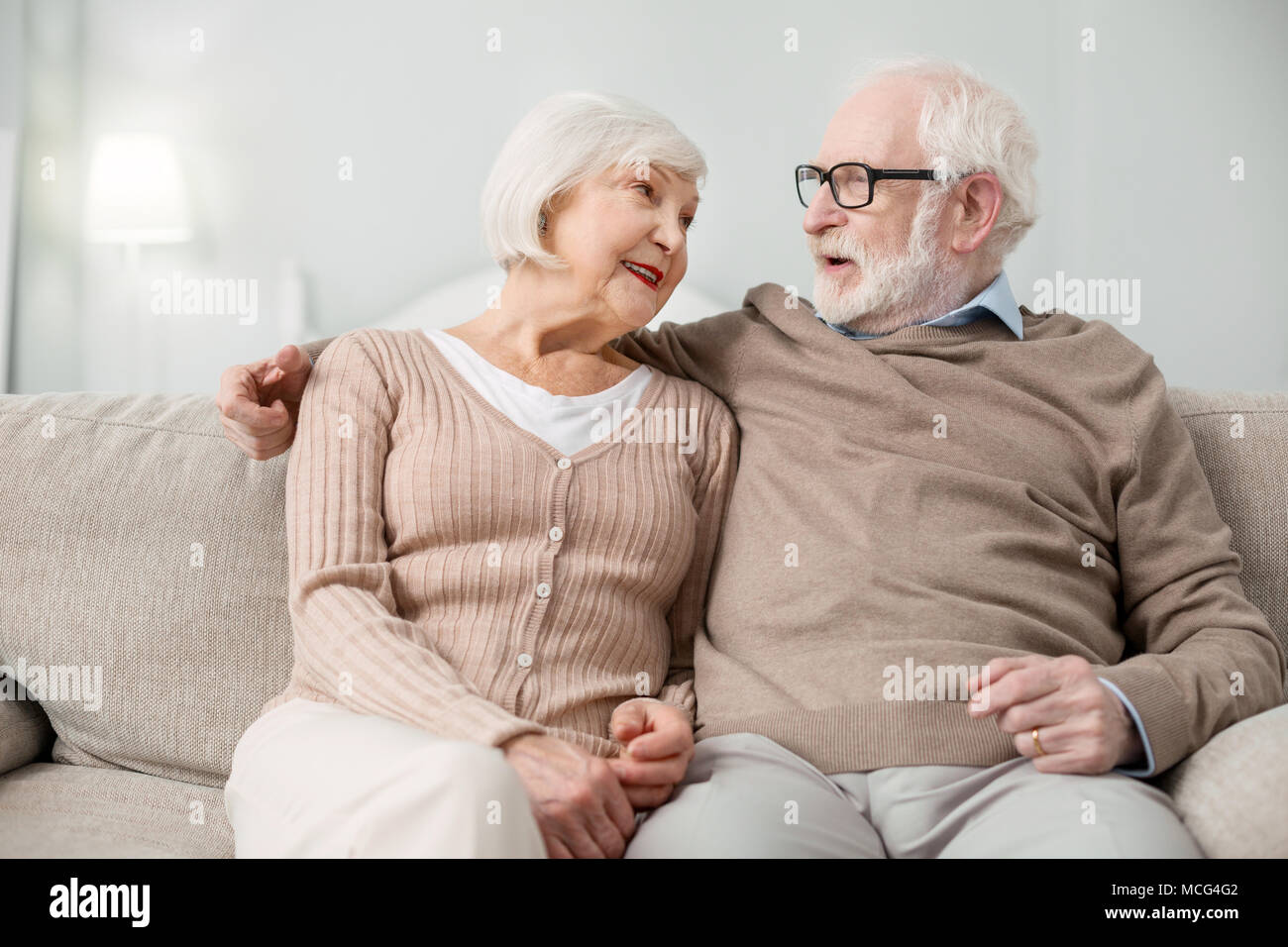 Positive aged man talking to his wife - Stock Image