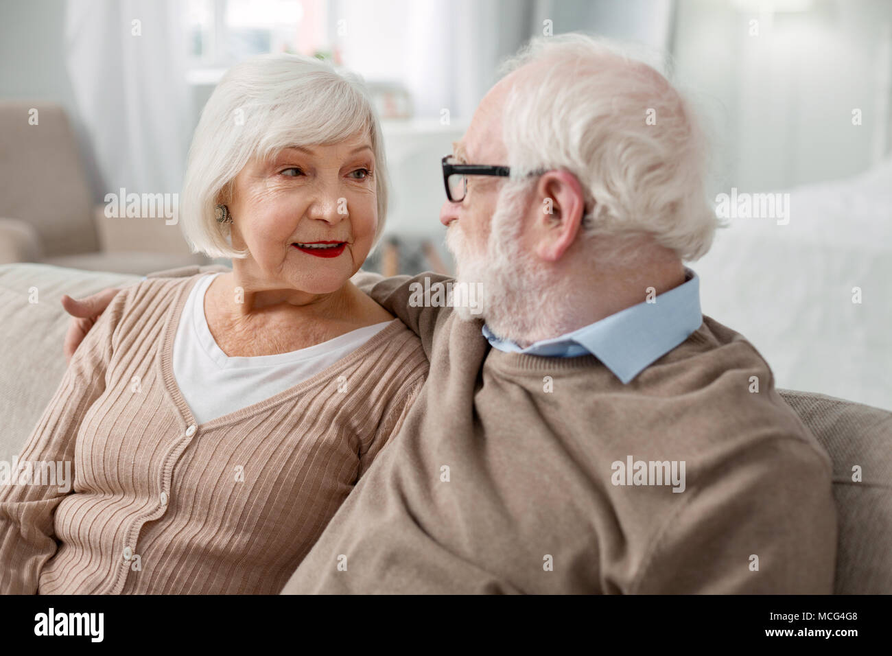 Nice aged man looking at his wife Stock Photo