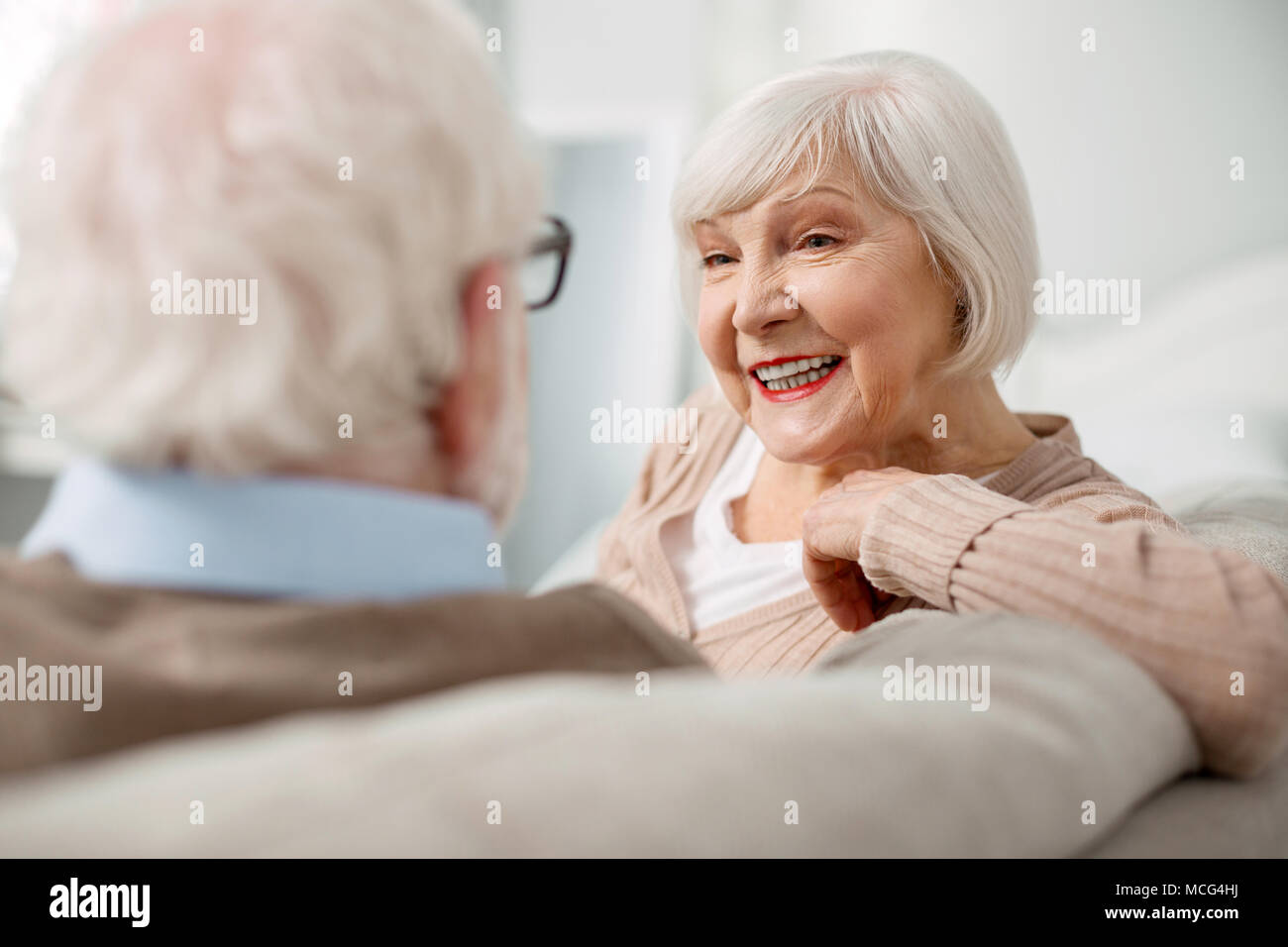 Portrait of happy elderly woman - Stock Image