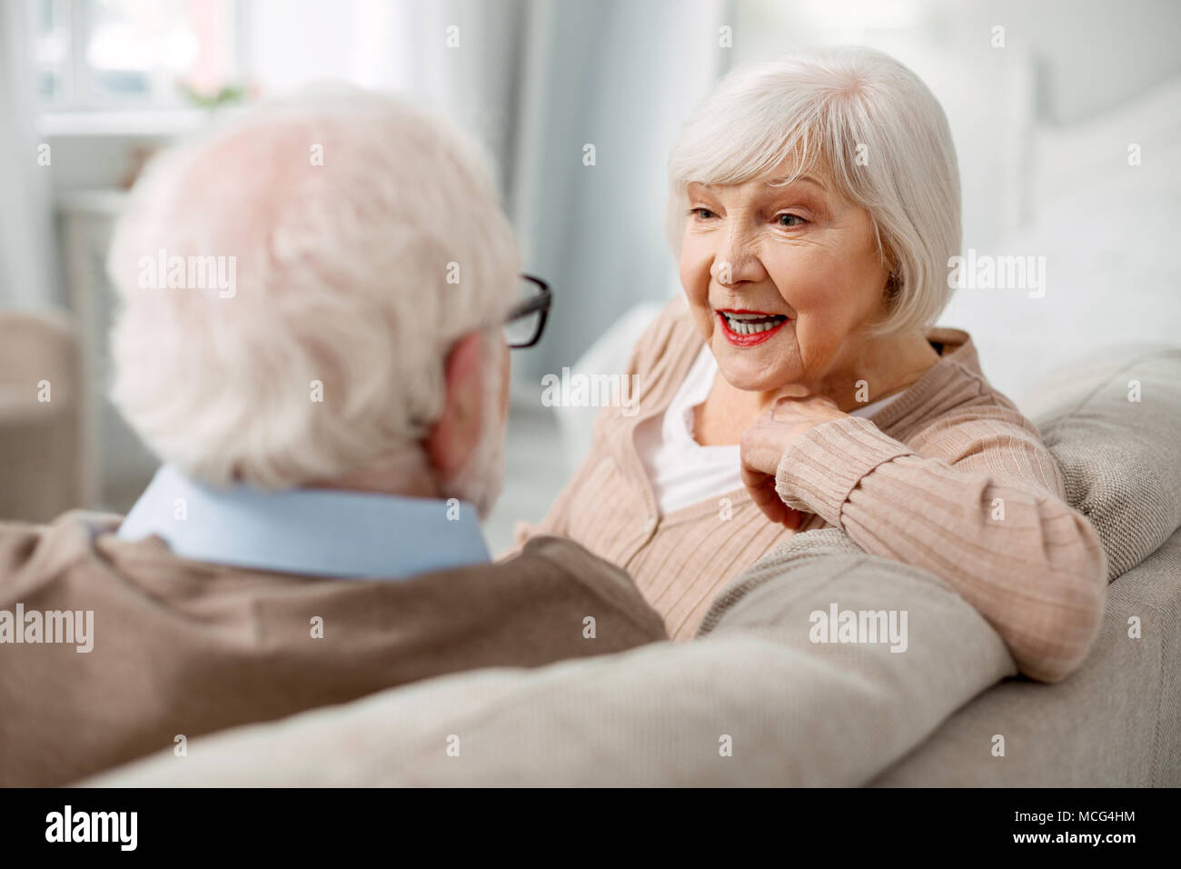 Nice elderly couple relaxing at home - Stock Image