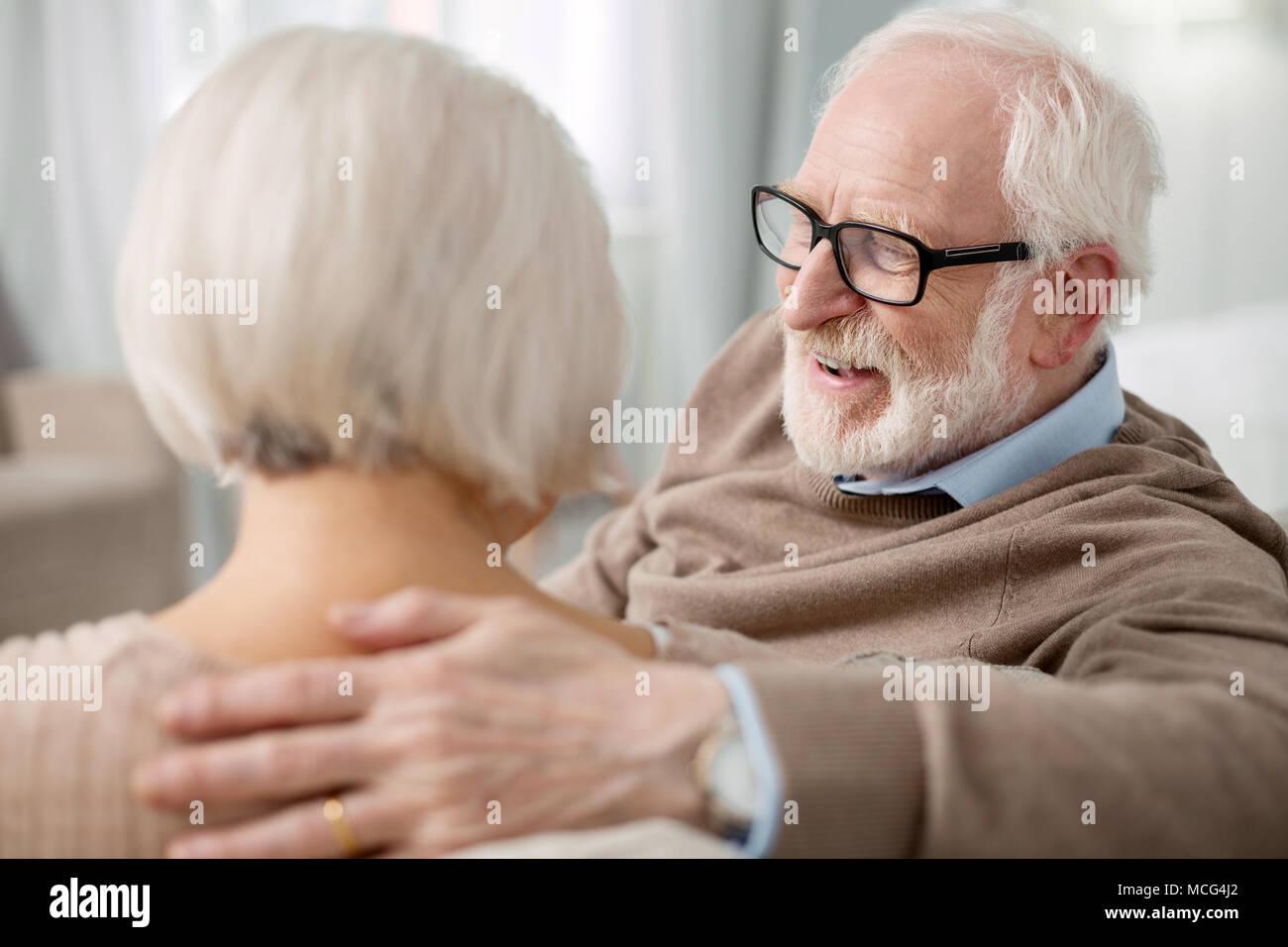 Positive senior man laughing - Stock Image