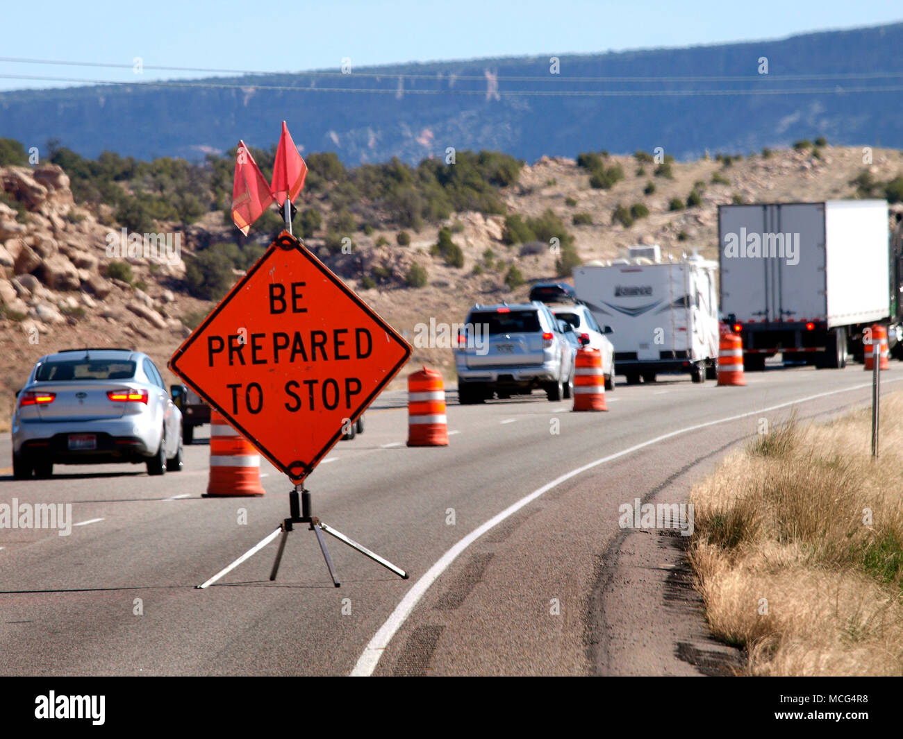 Going West, tourists fill up the roads and highways need to be widened. As they work to add an extra lane on US highway 191 between the Arches National Park and Canyonlands National Park. - Stock Image