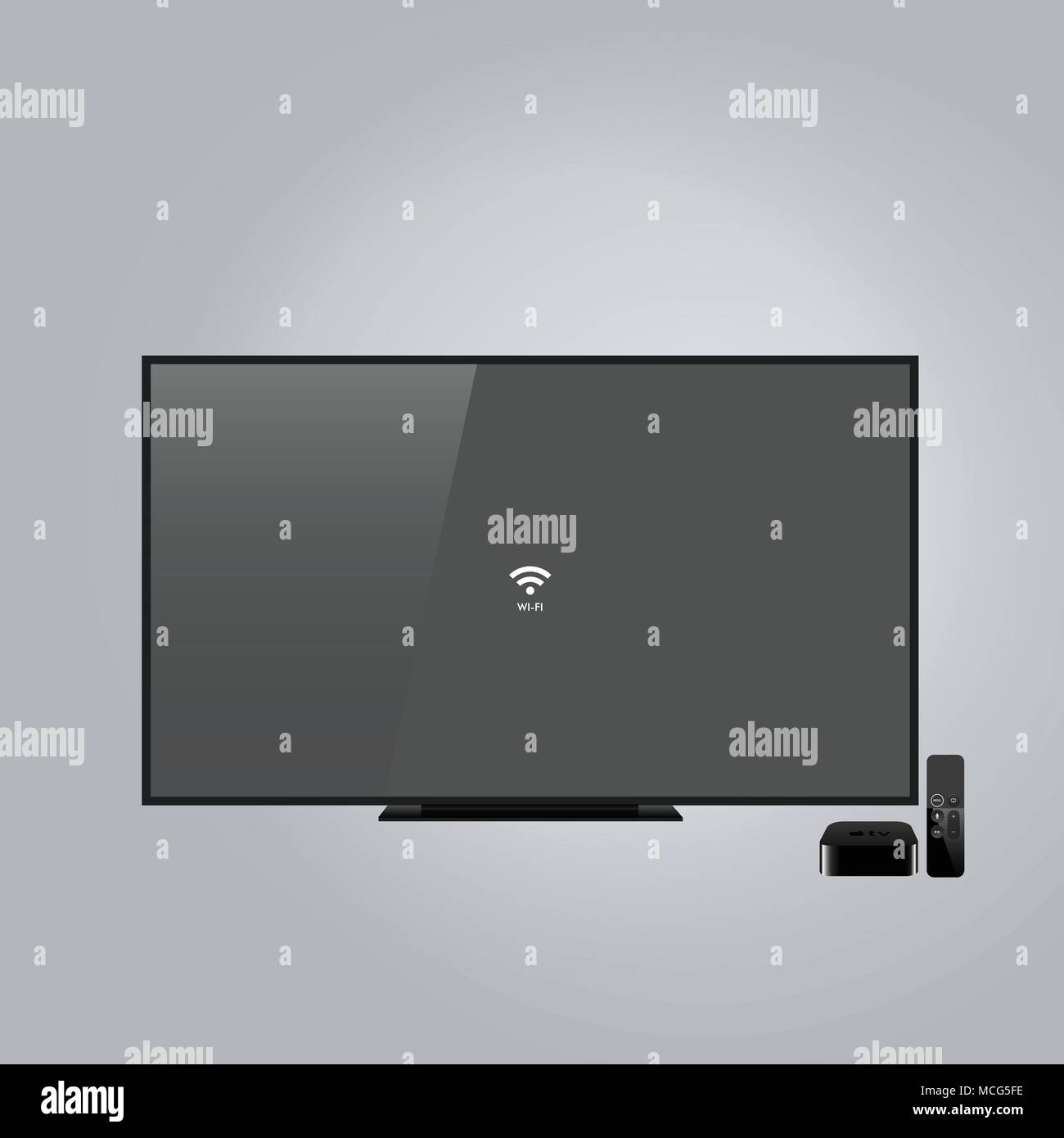 Wide screen black television, apple TV set isolated on gray background - Stock Image