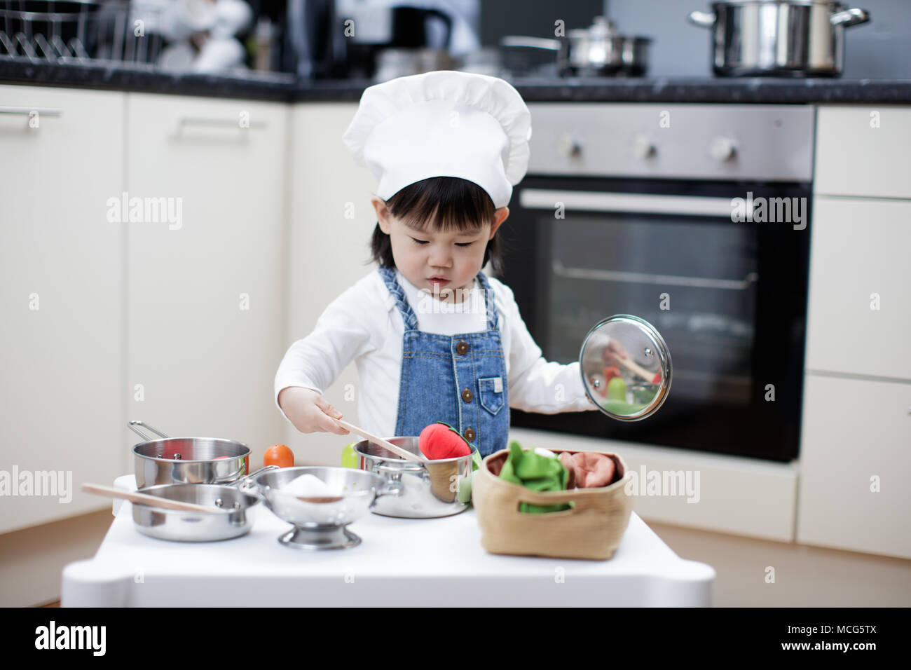 baby girl pretend play food toy - Stock Image