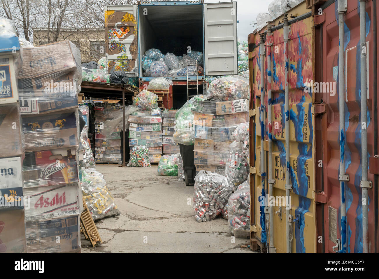 Thousands of bottles and cans await pick-up from distributors at the Sure We Can non-profit redemption center in the Bushwick neighborhood of Brooklyn in New York on Saturday, April 7, 2018. Canners from all over Brooklyn use this center to sort their finds and redeem the deposit money.  The bags of cans are stored until there are enough to fill a tractor trailer from each individual distributor who is responsible for picking them up. (©ÊRichard B. Levine) - Stock Image