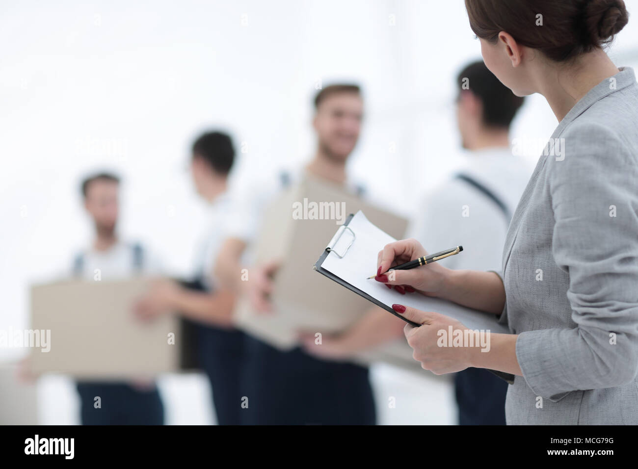 A team of professionals engaged in cargo transportation, - Stock Image