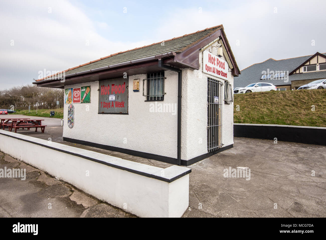 Small building used as a Hot food outlet claiming to be open all year round and 7 days a week.   Taken at Morecambe on 11 April 2018 - Stock Image