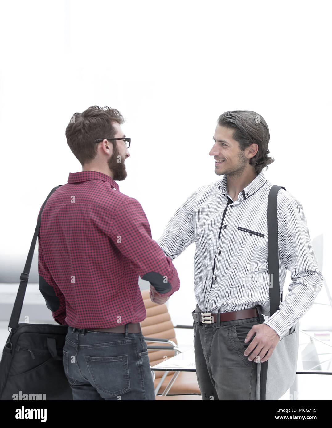 handshake Manager and the client in the office. - Stock Image