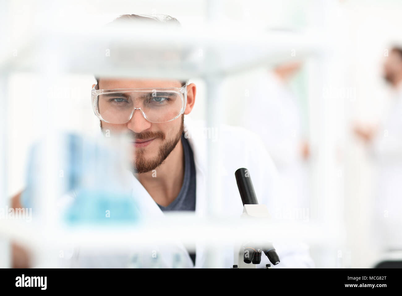closeup.male chemist on blurred background laboratory - Stock Image