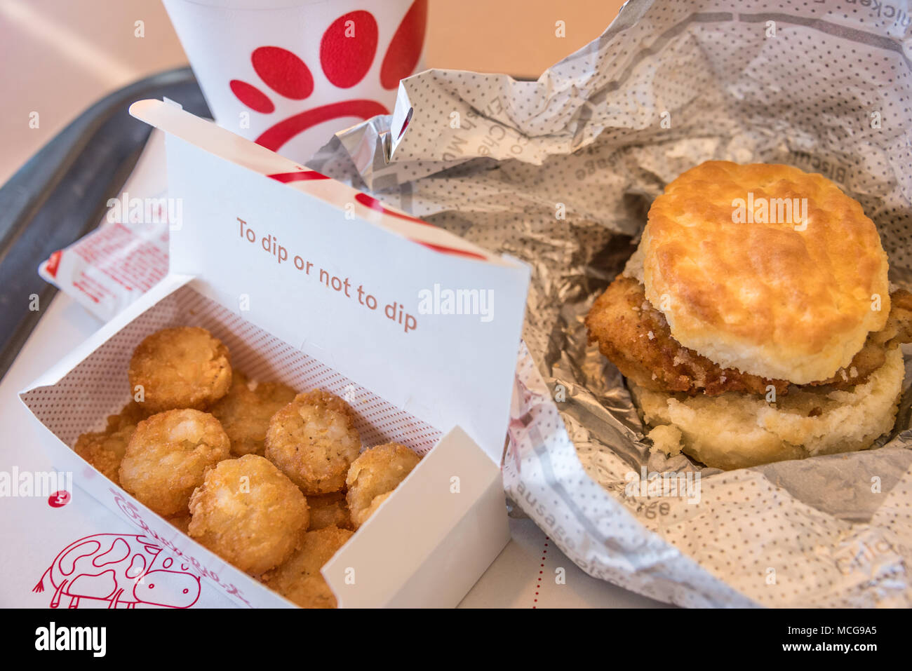 A classic chicken biscuit breakfast at Chick-fil-A, America's top-rated quick service restaurant. - Stock Image