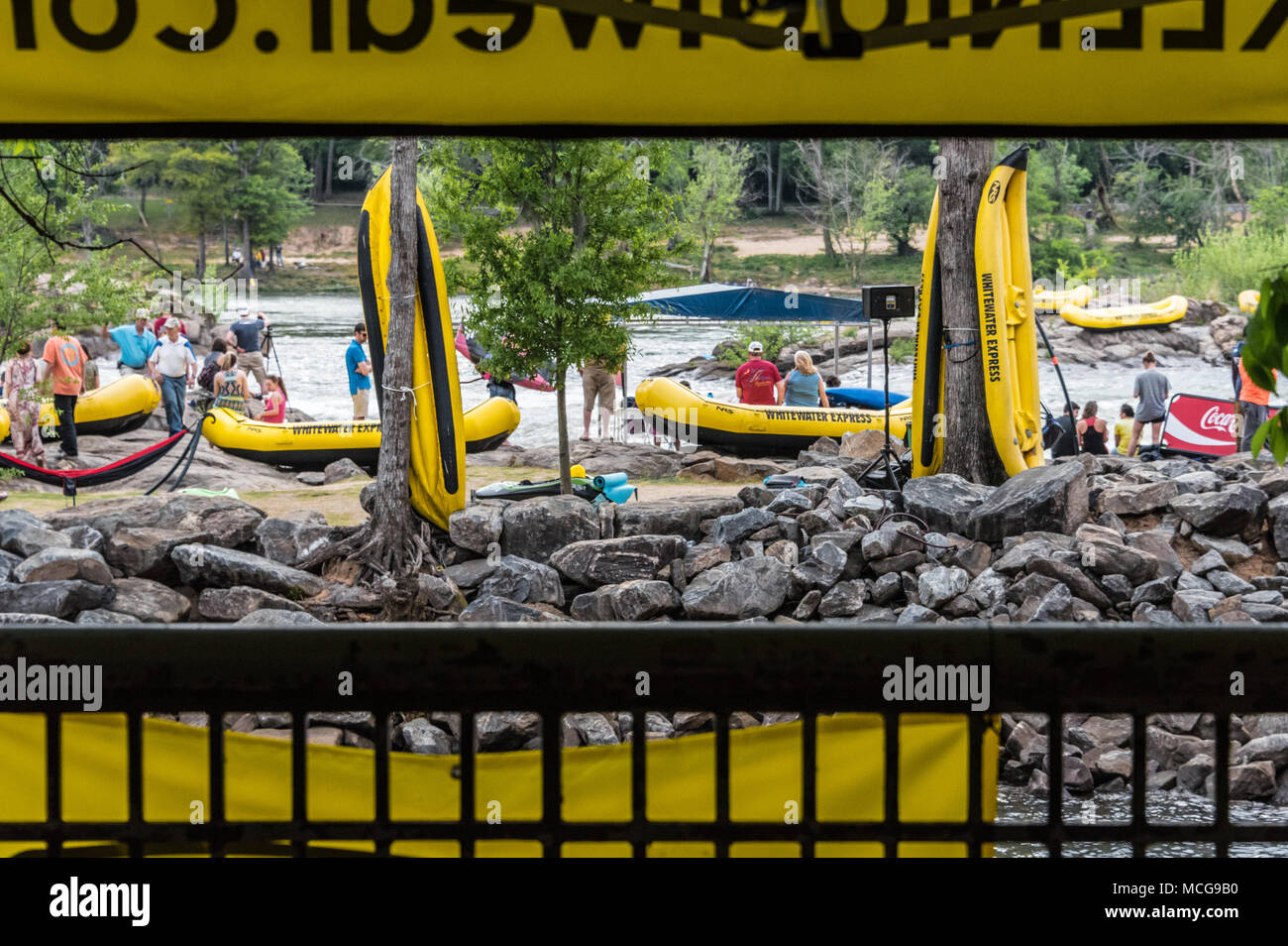 Whitewater rafts abound at Paddle South in Columbus, GA as spectators gather for the USA Freestyle Kayak National Championship. - Stock Image