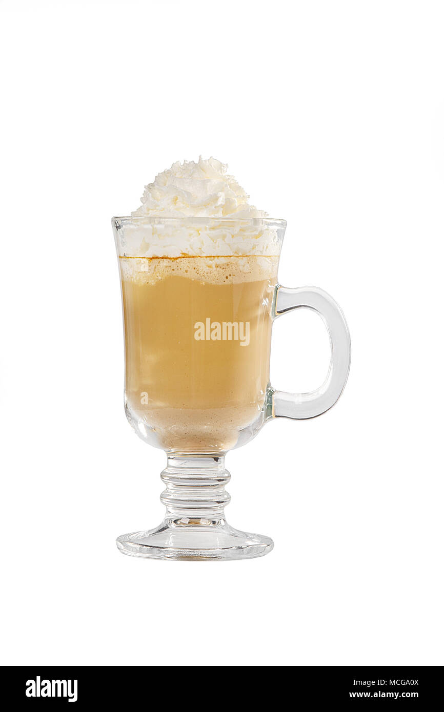 Single-color opaque cocktail, coffee with milk, cocoa, hot chocolate in a tall glass with a handle with whipped cream. Side view. Isolated white backg - Stock Image