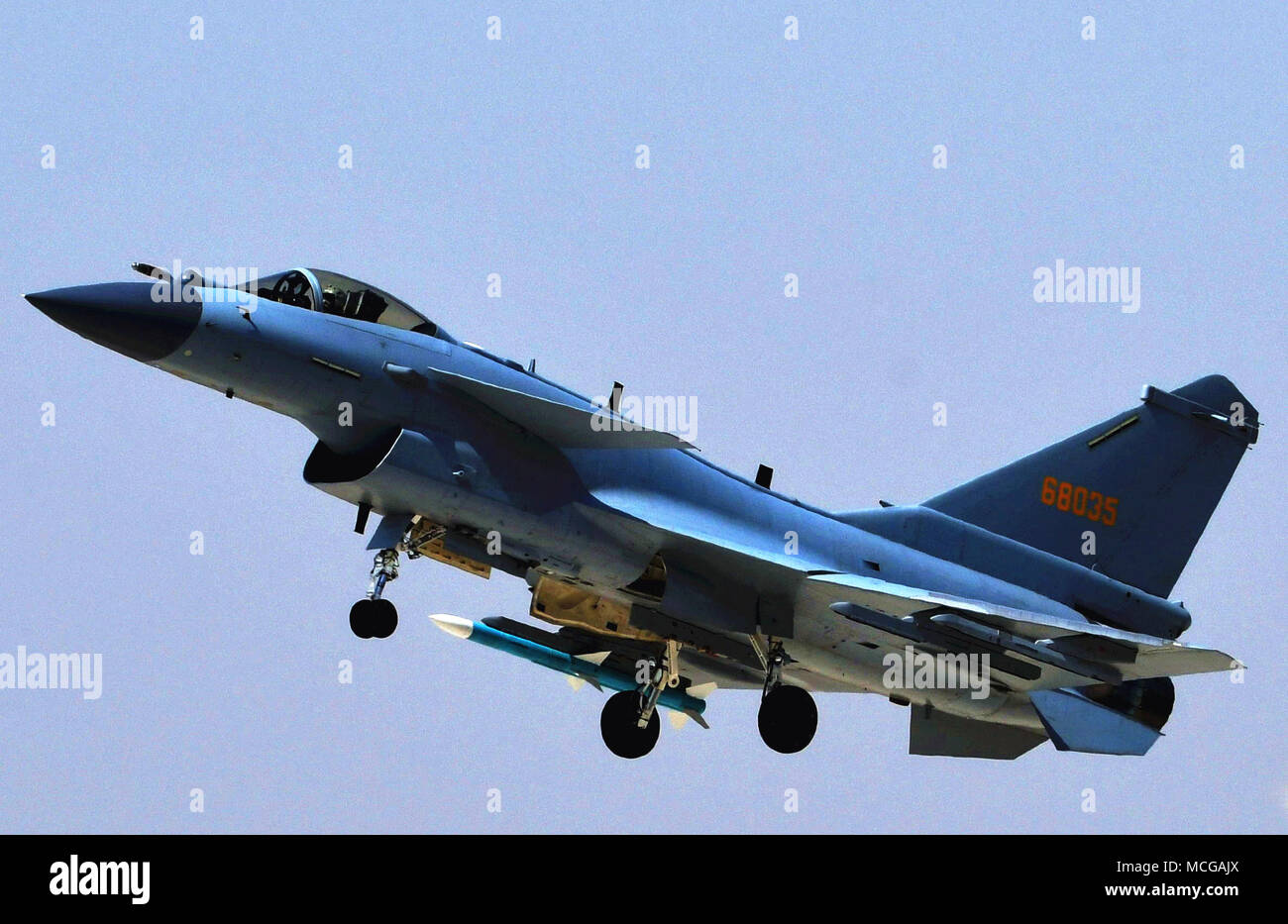 (180416) -- BEIJING, April 16, 2018 (Xinhua) -- Photo taken on April 12, 2018 shows a J-10C fighter jet in a training.  China's new multi-role fighter jet J-10C began combat duty Monday, the People's Liberation Army (PLA) air force announced.  It is China's third-generation supersonic fighter and made its debut when the PLA marked its 90th anniversary in July 2017 at Zhurihe military training base in Inner Mongolia Autonomous Region. Equipped with an advanced avionics system and various airborne weapons, the domestically-developed fighter has airstrike capabilities within medium and close rang - Stock Image