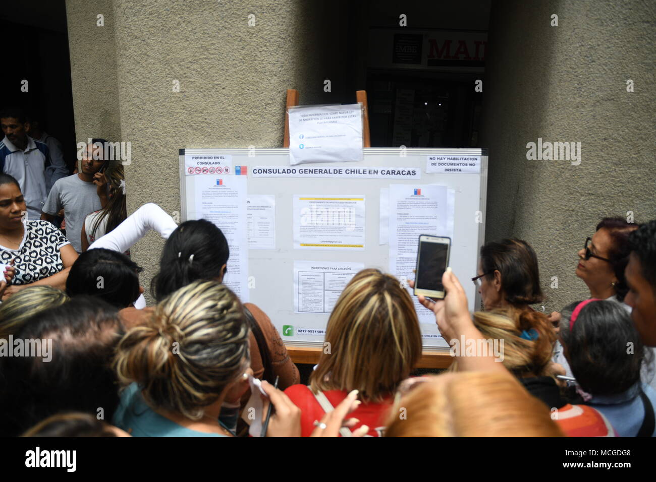 People Seen Reading The Notice Board For Visa Requirements Outside The Chilean Consulate In The City