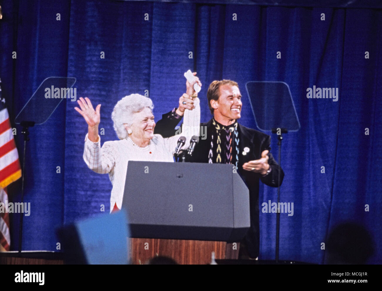 April 16, 2018 - (File Photo) - Former first lady Barbara Bush was reported in failing health and has decided not to seek further medical treatment, a family spokesman says. PICTURED:Feb. 16, 1992 - Derry, New Hampshire, United States of America - Actor ARNOLD SCHWARZENEGGER and first lady BARBARA BUSH speak at a campaign rally for the Bush/Quayle '92 ticket at the Pinkerton Academy in Derry, New Hampshire on February 16, 1992 prior to the 1992 New Hampshire Primary. Credit: Ron Sachs/CNP/ZUMAPRESS.com/Alamy Live News Stock Photo