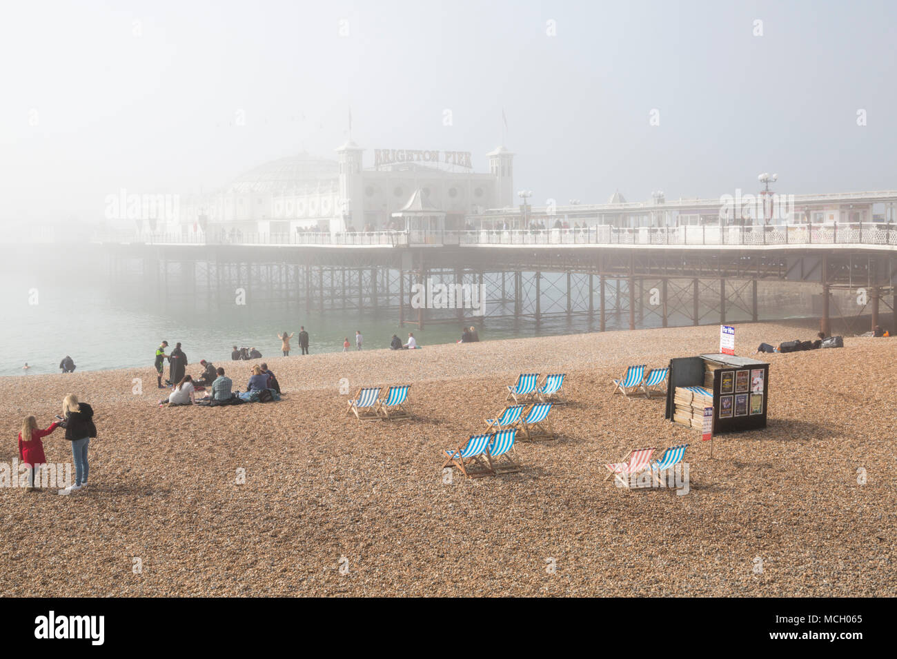 Brighton Palace Pier partially hidden by sea mist at Brighton, East Sussex, England UK in April - Stock Image