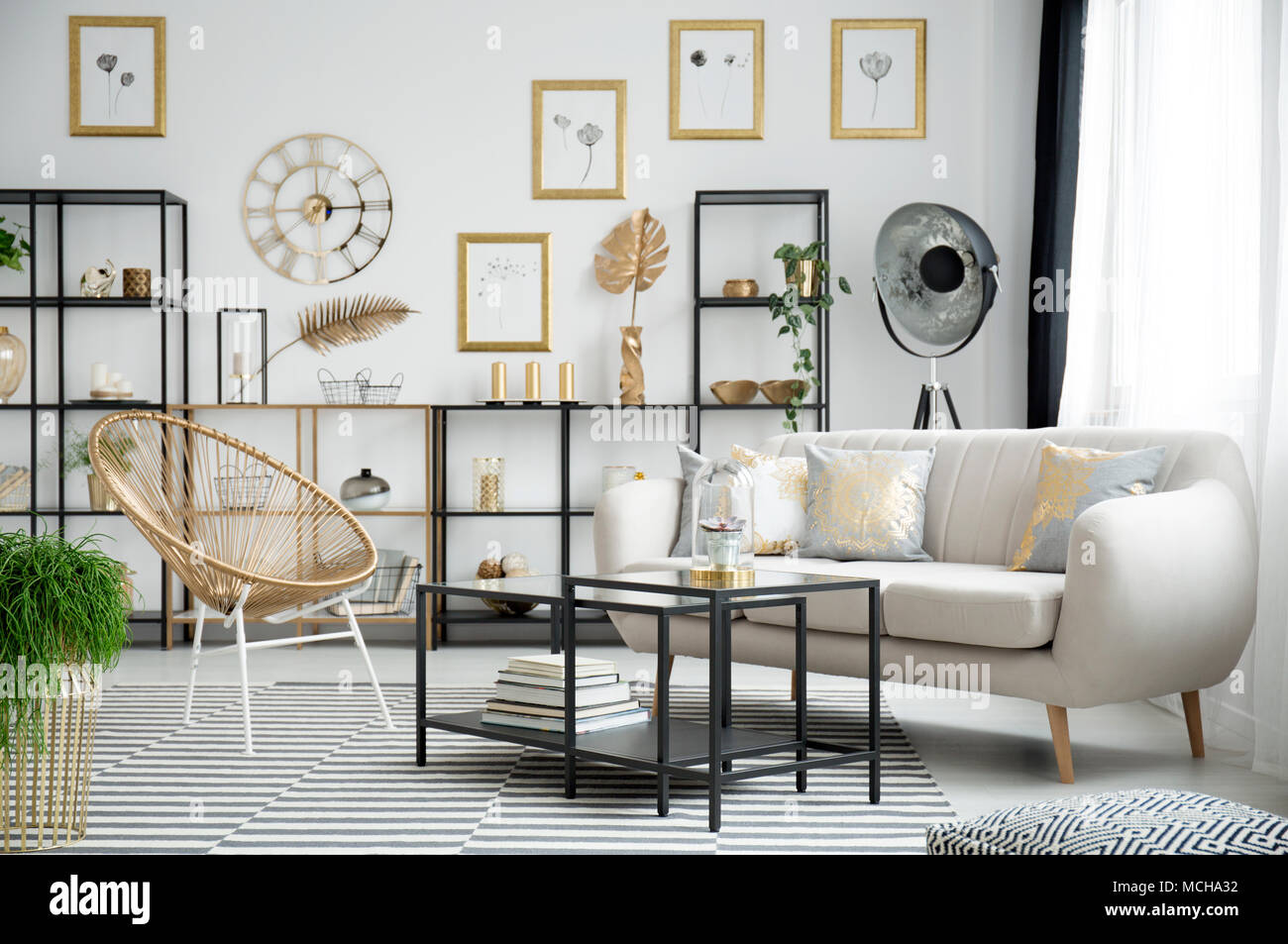 Gold chair next to black table and beige sofa in living room ...