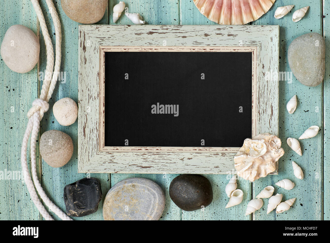 Blackboard With Maritime Decorations on light turquoise wood, text space Stock Photo