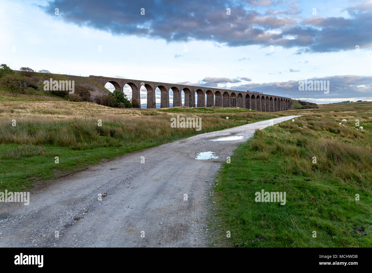 Near Ingleton, North Yorkshire, England, UK - September 11, 2016: A train passing the Ribblehead Viaduct on the Settle-Carlisle Railway Stock Photo