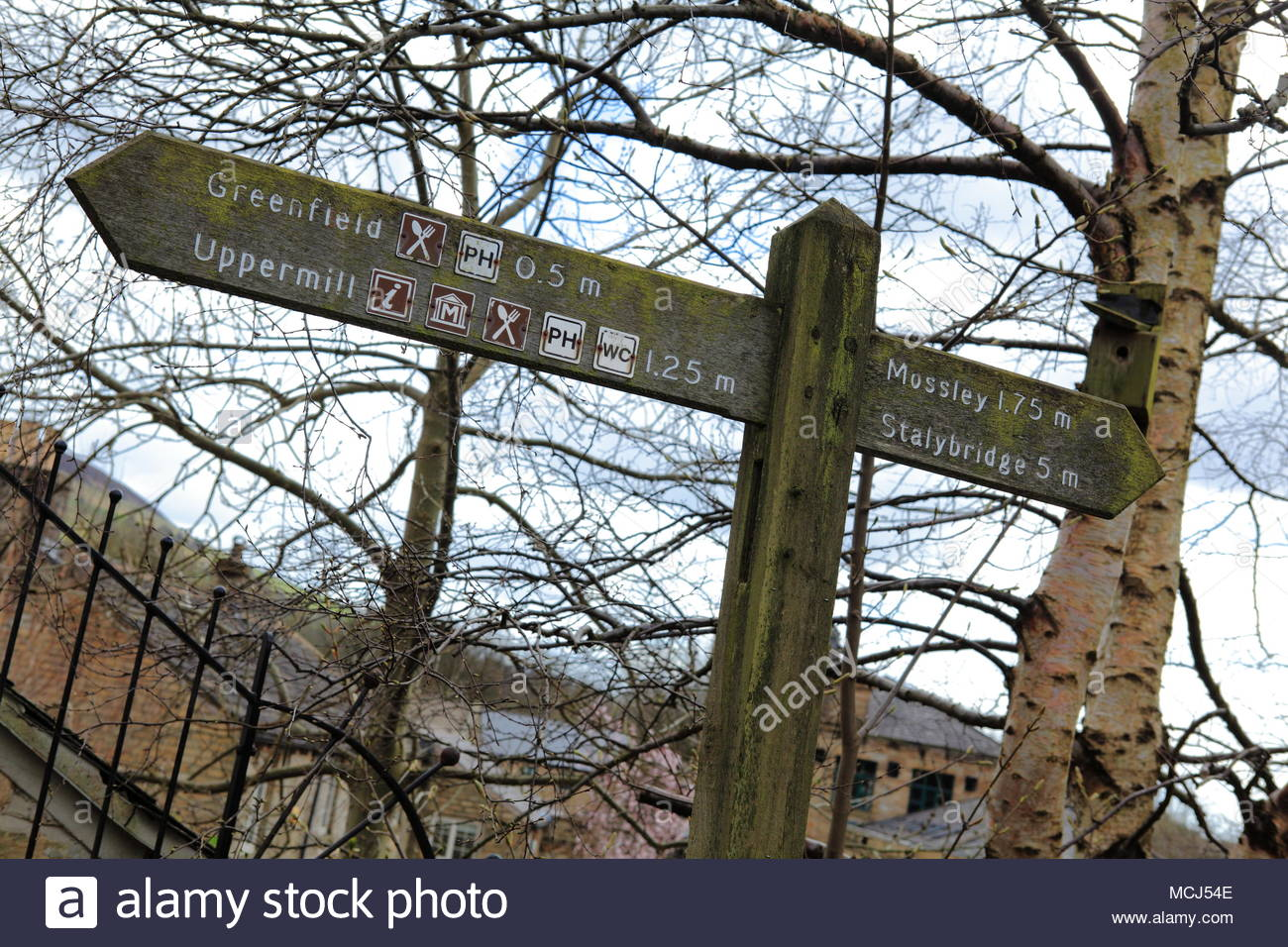 A Marker And Directional Sign Along The Huddersfield Canal At Friezland Greenfield England April 2018 - Stock Image