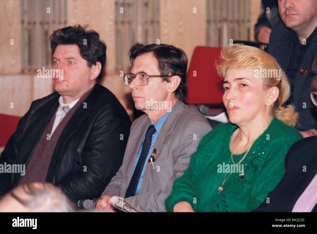 Moscow, Russia - February 22, 1992: Constituent congress of All-Russian Patriotic Movement 'Otchizna' (Fatherland). Members of the movement from left to right: Viktor Imantovich Alksnis, Alexander Nikolaevich Kraiko, Sazhi Zaindinovna Umalatova. - Stock Image