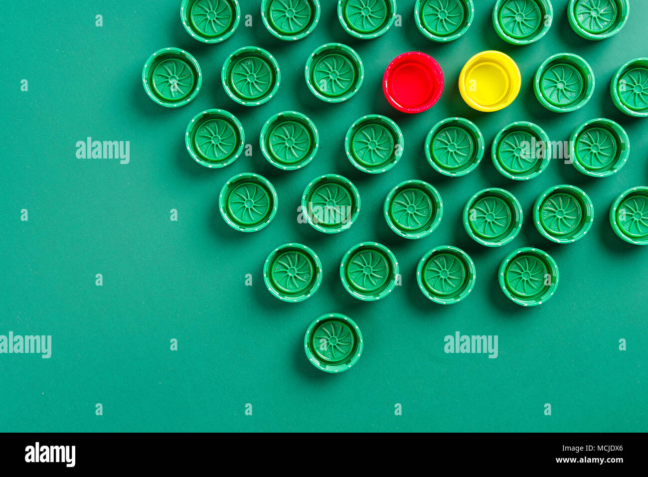covers from bottles in the form of a mosaic - Stock Image