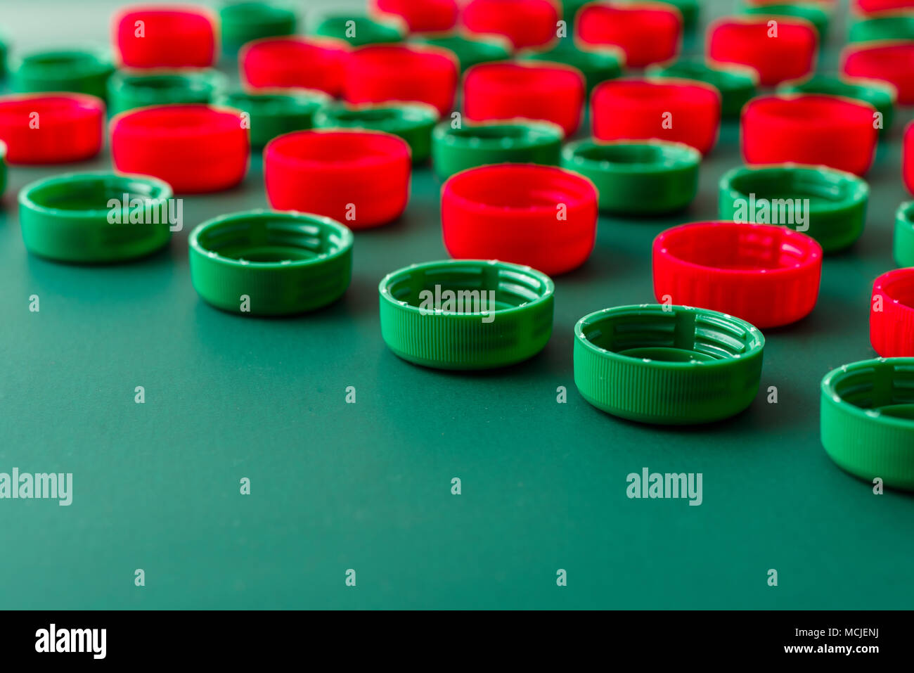 red and green plastic covers from PET bottles - Stock Image