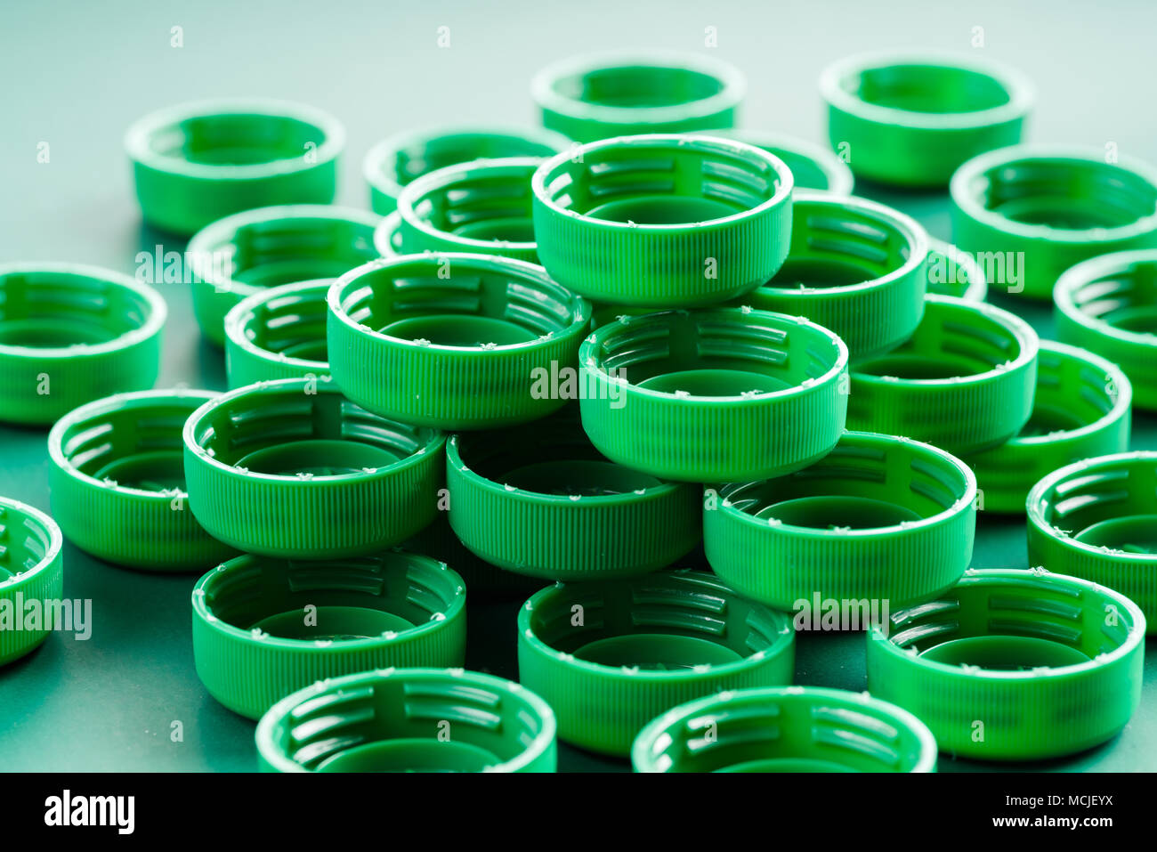 colored caps from plastic bottles - Stock Image