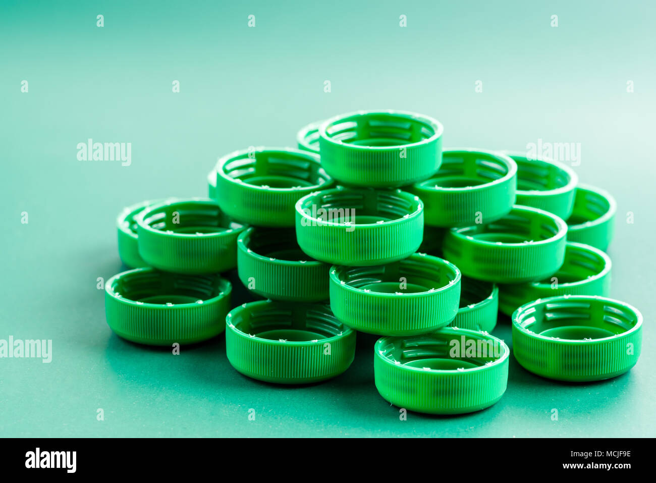 plastic green covers on a green background - Stock Image