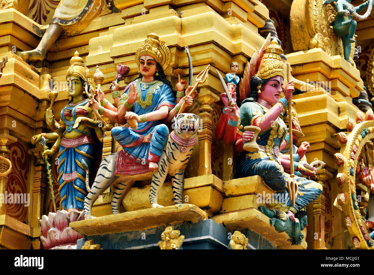 Colorful Hindu temple decorated with figures and gods, Sri Muthumariamman, Matale, Central Province, Sri Lanka - Stock Image