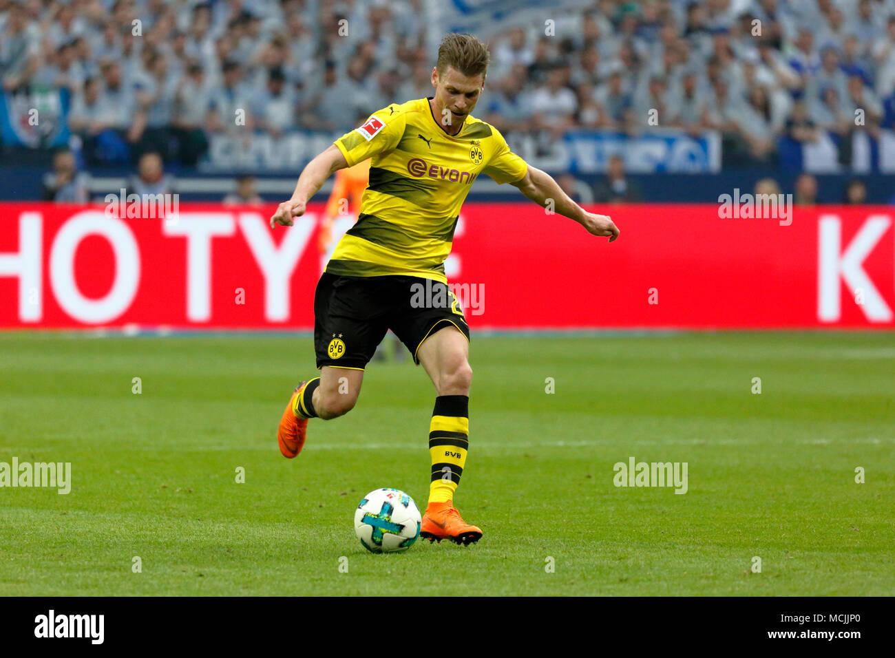 sports, football, Bundesliga, 2017/2018, FC Schalke 04 vs BVB Borussia Dortmund 2:0, Veltins Arena Gelsenkirchen, scene of the match, Lukasz Piszczek (BVB) in ball possession - Stock Image