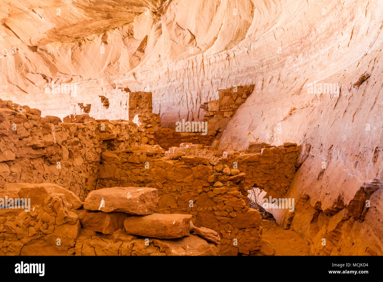 17 or 16 Room Ruin, an Ancestral Puebloan ruin in a north facing alcove along the San Juan River near Bluff, Utah. Stock Photo