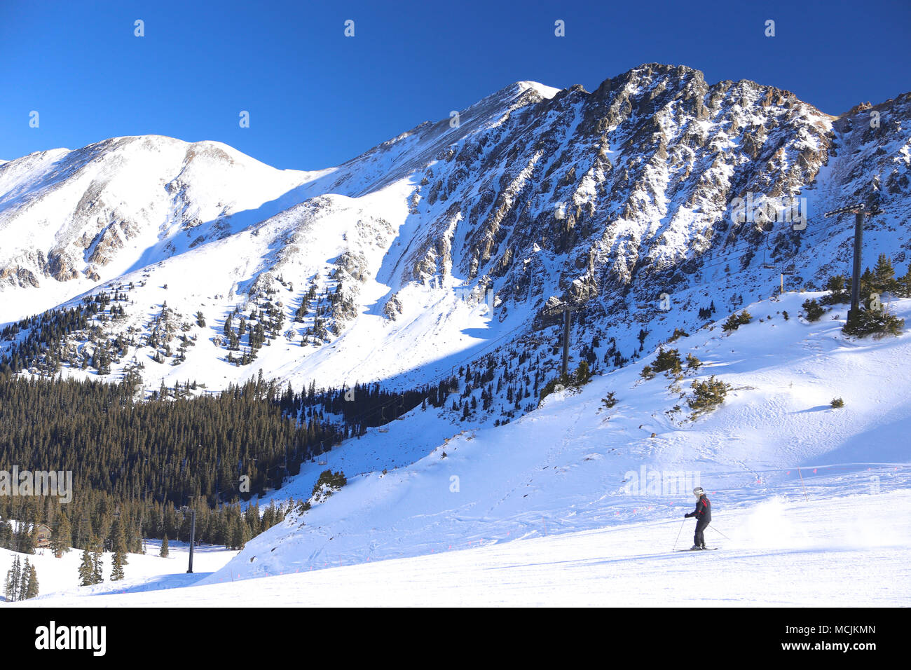Skier at Arapahoe Basin ski resort in the Colorado Rocky Mountains - Stock Image