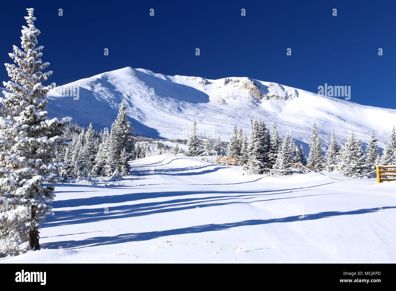 View of the snow covered Colorado Rocky Mountains from Breckenridge Ski Resort - Stock Image