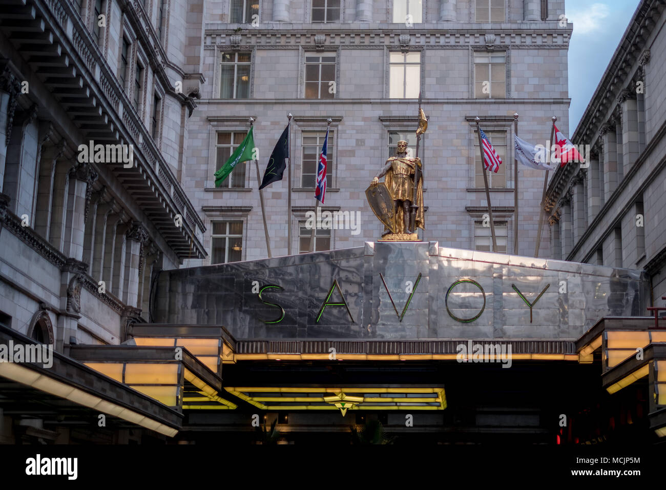 London UK, Entrance to the art deco style Savoy Hotel off The Strand. - Stock Image