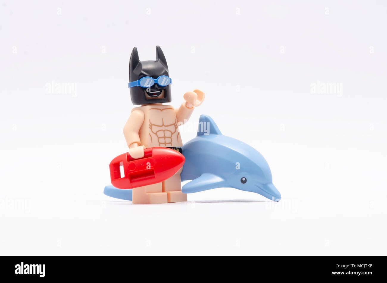 mini figure of  beach batman and a dolphin. Lego minifigures are manufactured by The Lego Group. - Stock Image