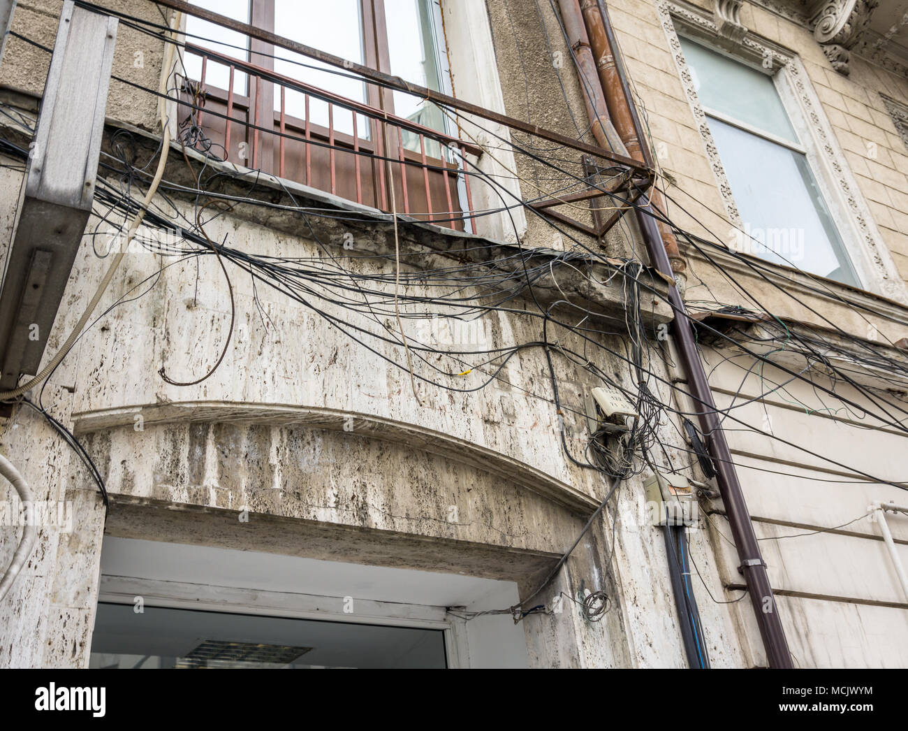 Electric cable mess in Bucharest, Romania. The complexity of the cable wire on street of Bucharest - Stock Image