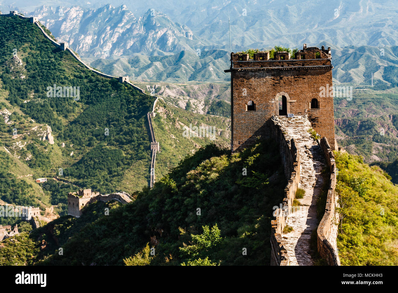 Closeup of tower entrance on Great Wall of China with mountainous  countryside in background - Stock Image