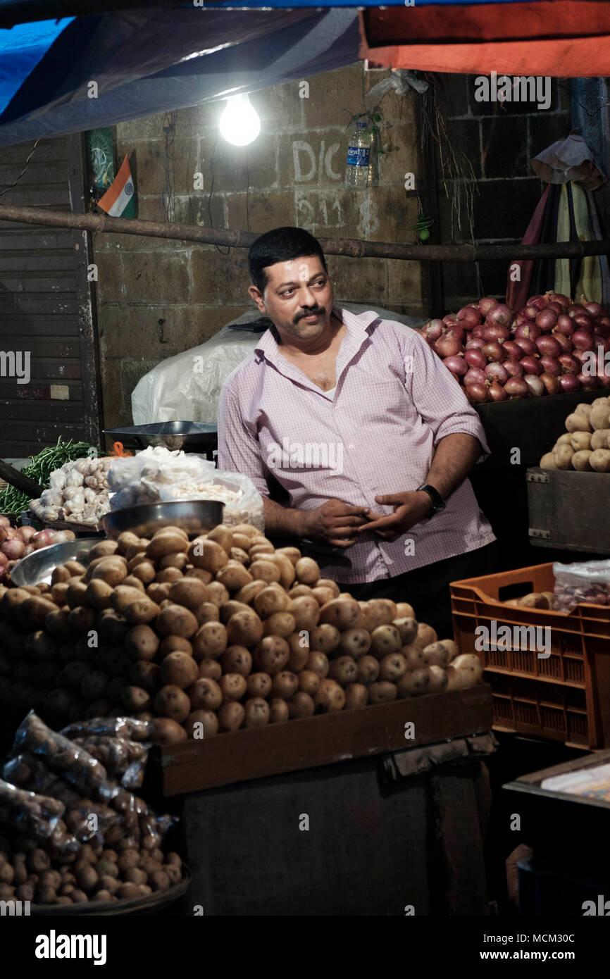 Vendors at the Grant Road vegetable market in inner city Mumbai - Stock Image