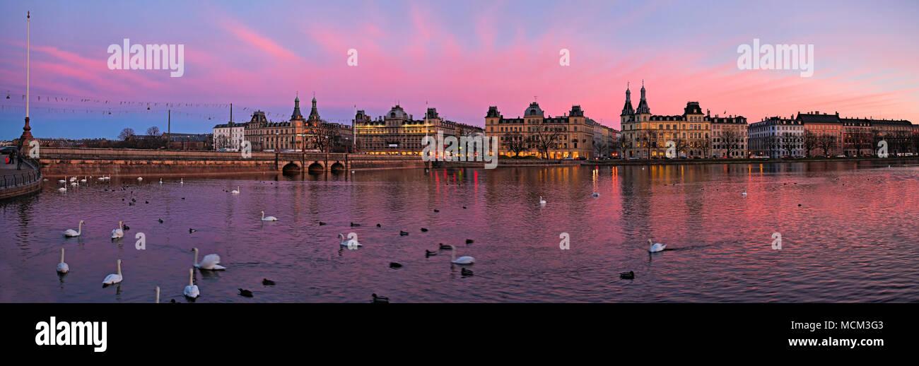 Copenhagen, Denmark - February 28, 2007: Dronning Louises Bridge and sotorvet buildings at sunset. - Stock Image